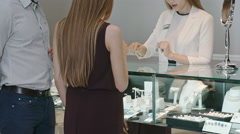Jewelry Saleswoman Working with Two Customers Stock Footage