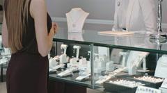 Woman Choosing Gemstone Necklace and Earrings Stock Footage