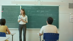 Learn English confident beautiful woman teacher chalk blackboard Stock Footage
