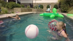 Happy children swimming in the pool. Kids Inflatable Giant Rideable Turtle. Stock Footage