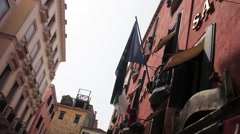 Italian flag in front of hotel Stock Footage