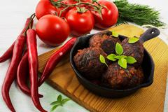 Grilled meatballs with chili pepper  served in skillet Stock Photos