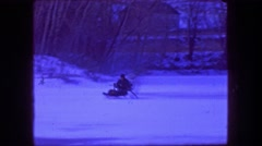 1961: Man driving fan hovercraft over frozen ice pond winter wilderness. Stock Footage