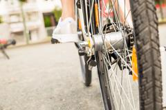 Close-up Of A Female Cyclist Riding A Bicycle Outdoors Stock Photos