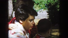 1959: Mother sons interaction mourning coffee outdoor picnic camping fun. CAPE - stock footage