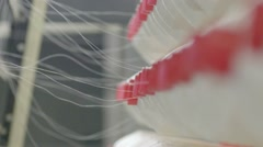 Spool of white thread on the textile manufacture Stock Footage