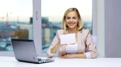Businesswoman showing blank paper card at office Stock Footage