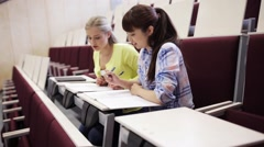 Student girls with notebooks in lecture hall Stock Footage