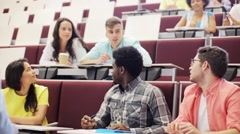 Group of students and teacher in lecture hall Stock Footage