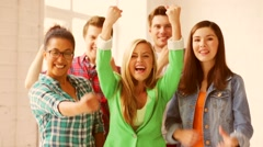 Students in school with expression of triumph Stock Footage
