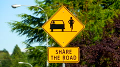 4K Bicycle and Car Vehicle Sharing Road, Yellow Diamond Sign Stock Footage