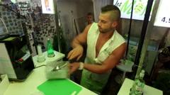 Dancing barman makes refreshing traditional cuban mojito Arkistovideo