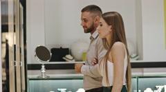 Boyfriend and Girlfriend in Jewelry Store Stock Footage
