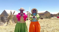 Local women on Lake Titicaca singing in native language Stock Footage