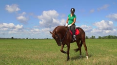 Woman ride horse hoof beats and play with rider Stock Footage