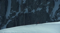 Mountaineer descending from the Aiguille du Midi to the Vallee Blanche glacier Stock Footage