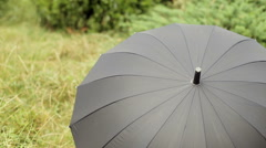 Little Girl Playing With Black Umbrella Stock Footage