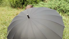 Little Girl Handling Black Umbrella Stock Footage