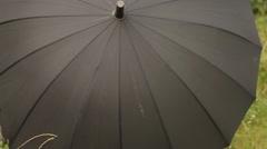 Rotating Black Umbrella Stock Footage