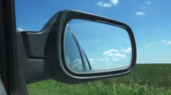 Driving through countryside, view in car side mirror Arkistovideo