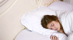 Woman stretching in bed after wake up. luxury interior Stock Footage