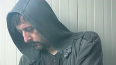 Hopeless hooded man in desperate situation Stock Footage