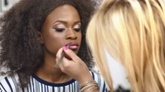 Woman makeup artist applying and correcting sparkling golden makeup on fabulous - stock footage