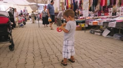 Commodity market street and a small boy with a sword Stock Footage