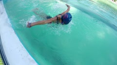 Girl training swimming butterfly stroke style in pool, SLOW MOTION Stock Footage