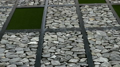 The design of stone and artificial grass wall Stock Footage