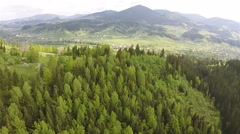 Aerial.  Wood on slopes of mountains with turn Stock Footage