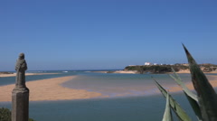 View of the beach at low tide in Vila Nova De Milfontes, Portugal Stock Footage
