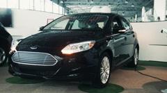 ZAPOROZHYE, UKRAINE  Man inserting power plug to electric car Stock Footage