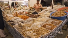 Dry fruits and nuts counter at the market Stock Footage