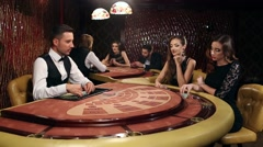 Two Beautiful Women Playing Blackjack Stock Footage