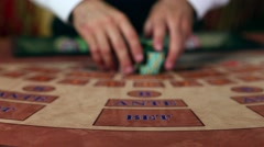 Croupier Moves Chips on Table at Casino Stock Footage