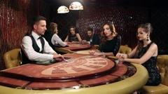 Dealer Shuffles the Young Women in the Casino Stock Footage