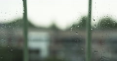 Water spills over window glass Stock Footage