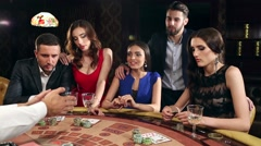 Lucky Woman Winning Money in the Casino Stock Footage