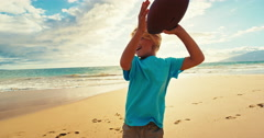 Boy Throwing Football Stock Footage