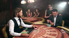 Pair Placing Their Bets on the Blackjack Table Stock Footage