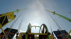 Bungee jump ball at a fun fair against the sunset Stock Footage