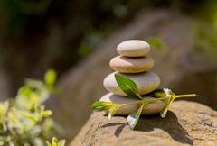 Pile of balancing pebble stones outdoor - stock photo