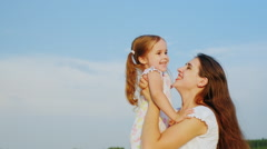 Children's games. Mom plays with her daughter, tossing it high in the sky - stock footage