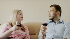 Couple clinks glasses of wine Stock Footage