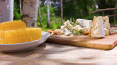 Country breakfast in the fresh air with honey and cheese - stock footage