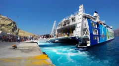 Tourists boarding a super ferry at Santorini's port Stock Footage