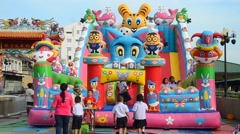 Thai children playing inflatable playground or Inflatable Toy Stock Footage