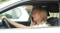 Frustrated woman stuck in a traffic jam. girl talking on the phone in the car Stock Footage