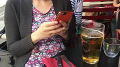 Girl Send Message On Smart Phone In a Bar, 4k Stock Footage